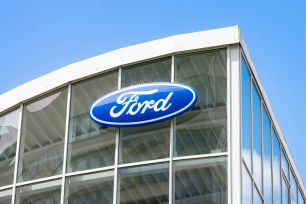 Logo of Ford at a car dealership Frankfurt, Hesse/Germany - November 01, 2019: Ford logo on the glass facade of a car dealership vehicle brand name stock pictures, royalty-free photos & images