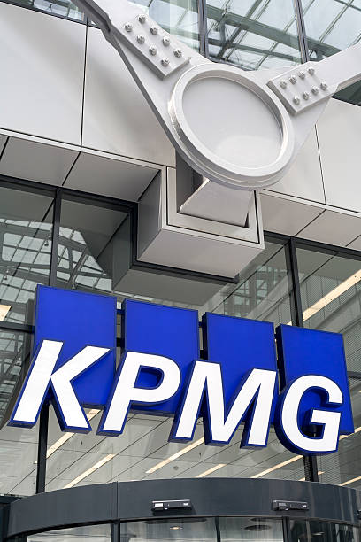 Logo of KPMG Frankfurt, Germany - July 3, 2011: Logo of KPMG International on office buildings facade in Frankfurt. KPMG is one of the largest professional services firms in the world and headquartered in Amsterdam, The Netherlands k logo stock pictures, royalty-free photos & images