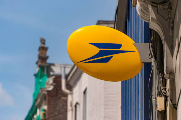 Logo of La Poste, French national postal service Lille, France - 15 June 2018: Logo of La Poste, French national postal service on Rue Nationale. hauts de france stock pictures, royalty-free photos & images
