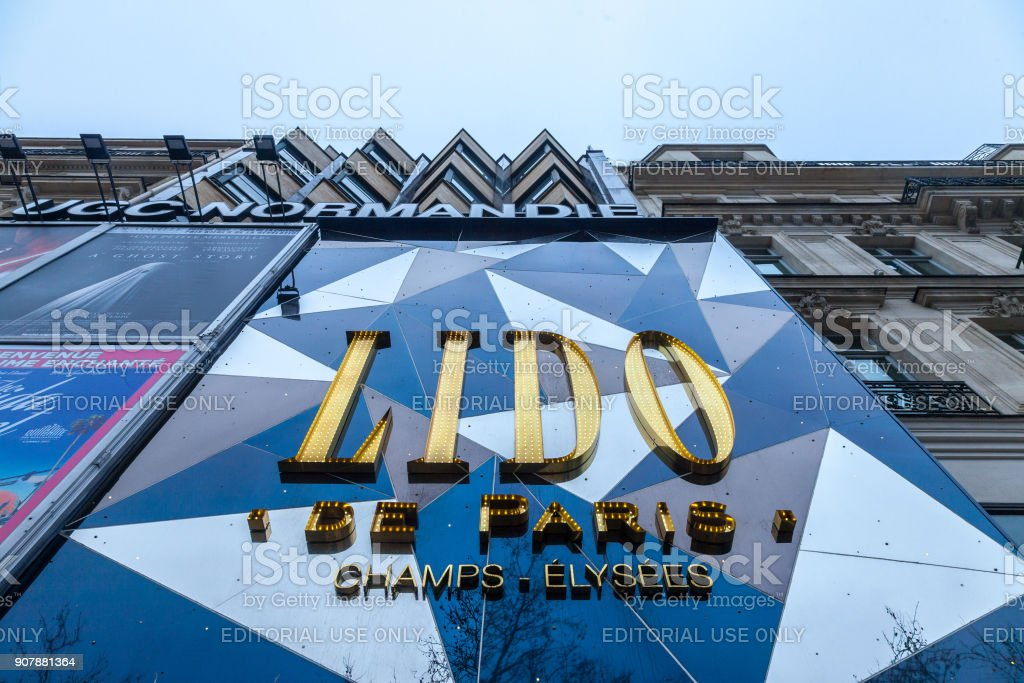 Logo of Lido de Paris club on their main building during the afternoon. Le Lido is a cabaret and burlesque show located on the Champs Elysees in Paris, France stock photo