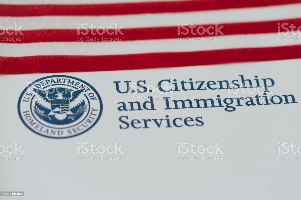 Logo of U.S. Citizenship and Immigration Services stock photo