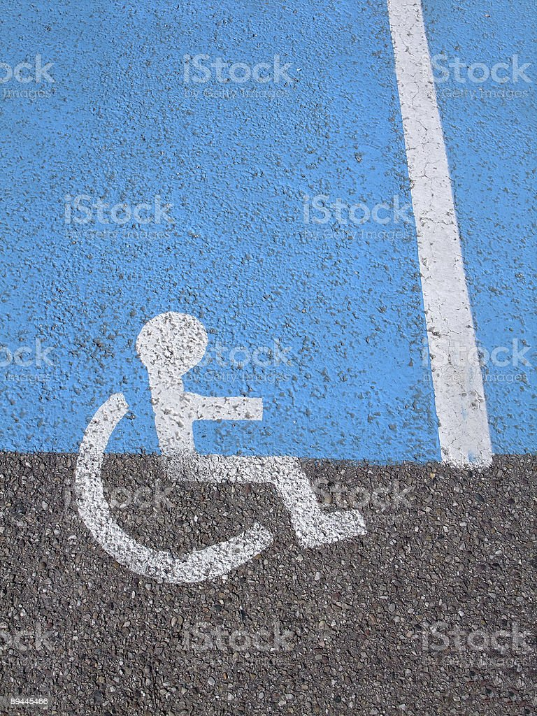 Logo on asphalt for disabled persons royalty-free stock photo
