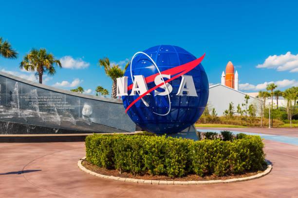 nasa logo on globe at kennedy space center florida - rocket logo stock photos and pictures