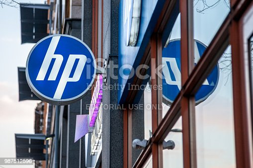 Picture of an HP Shop sign on their main store in Budapest, Hungary. HP, formerly Hewlett Packard, is an American technology company which develops personal computers (PCs), printers and related supplies, as well as 3D solutions