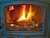 Fire in old fashioned metal heater