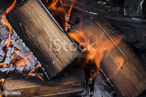 istock Logs burn in the fire. Selective focus. 1134738923