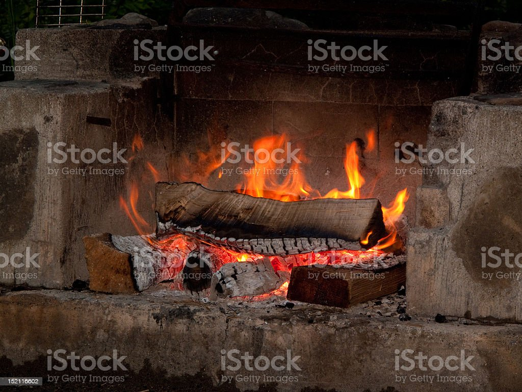 Logs burning in concrete stove oven royalty-free stock photo