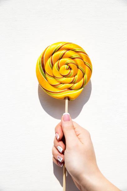 Lollypop on a stick ina hand picture id1142146331?b=1&k=6&m=1142146331&s=612x612&w=0&h=tkf4ah3avqhaj9jywyzc57hpbxcgskcqs9ppolqetmk=