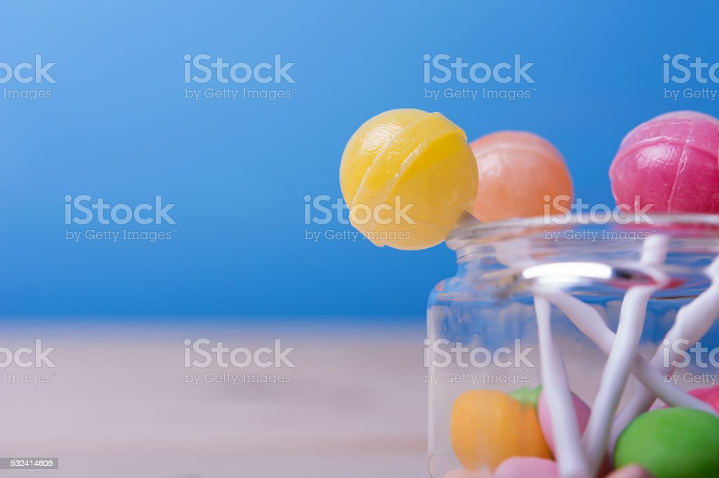Lolopops in jar on wooden table stock photo