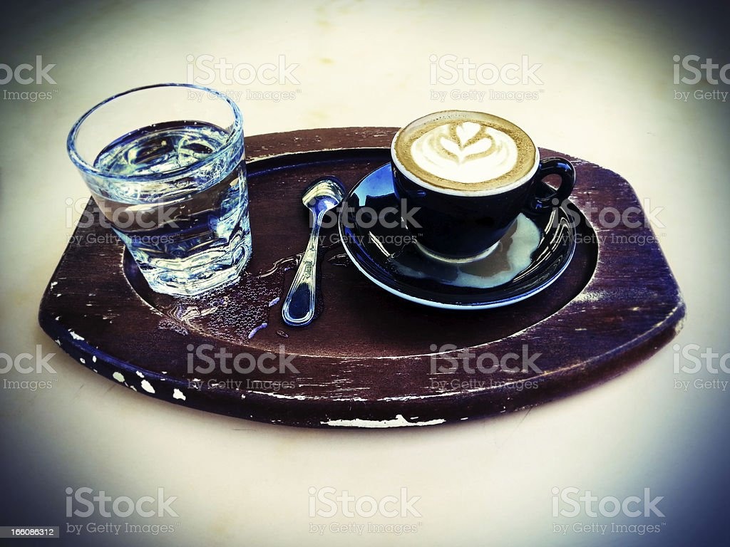 Lomo Cappuccino and Sparkling Water on a Tray royalty-free stock photo