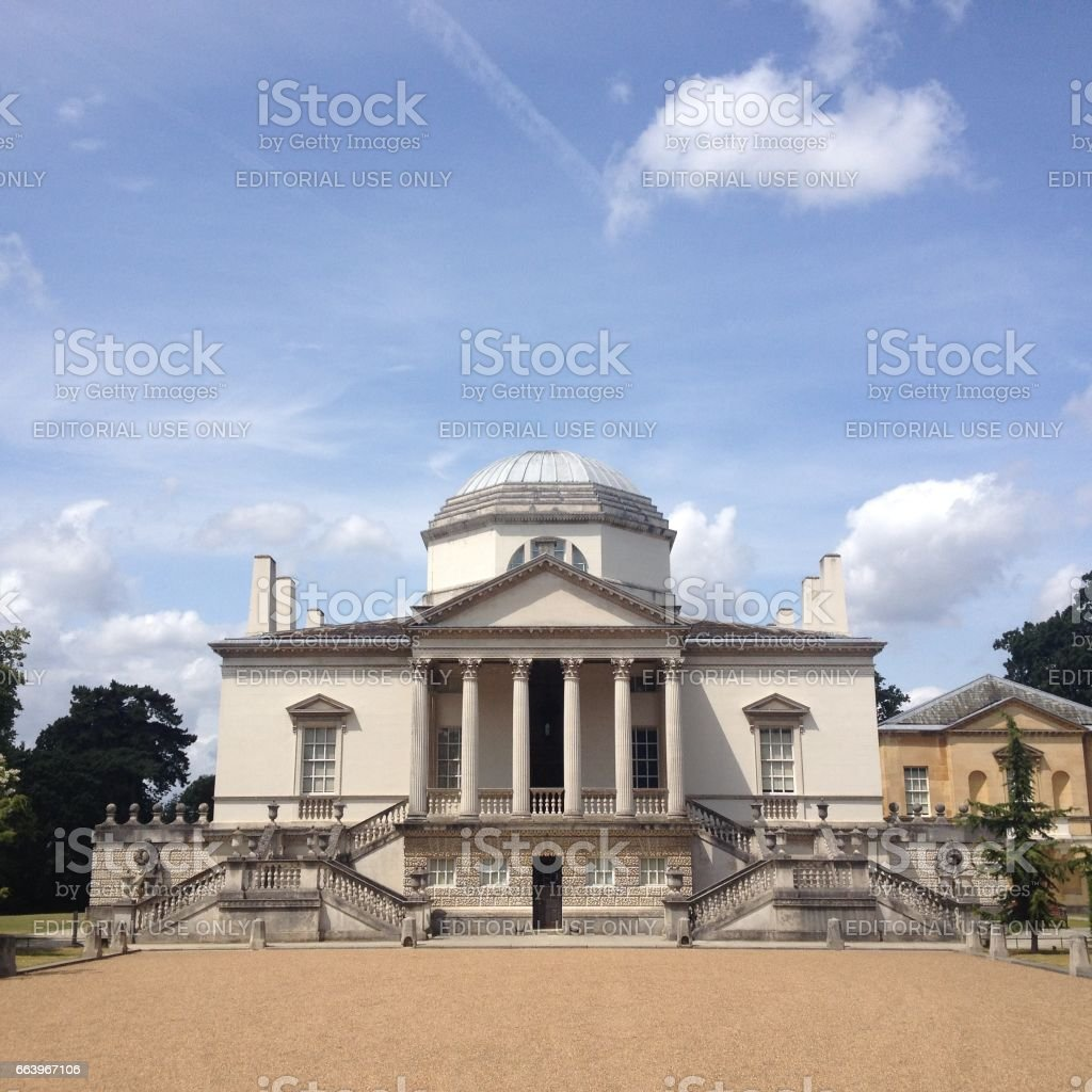 London - 17 July 2015: Entrance to Chiswick House designed by Lord Burlington in 1729 is one of the finest examples of Neo-Palladian architecture in London. stock photo