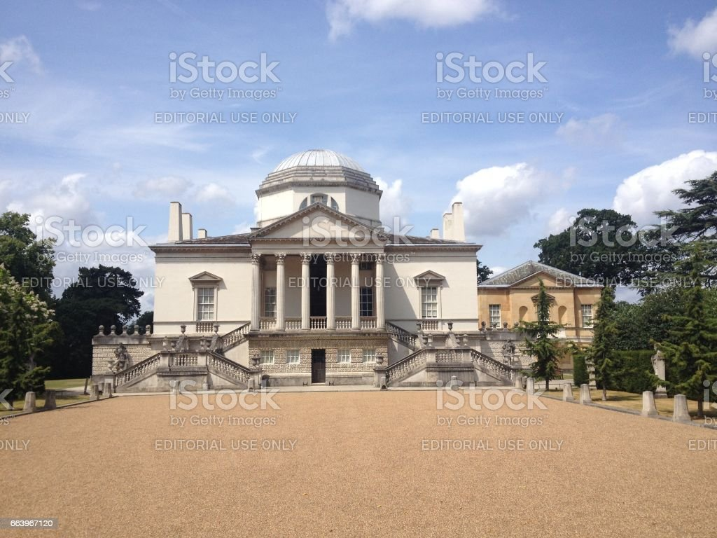 London - 17 July 2015: Long driveway leading to the entrance of Chiswick House designed by Lord Burlington in 1729. Finest example of Neo-Palladian architecture in London, UK. stock photo