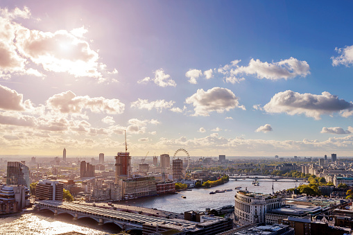 London aerial cityscape with landmarks of South Bank including London Eye and Westminster Palace.