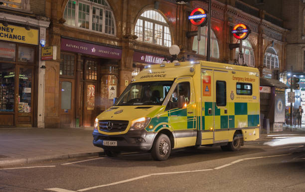 London ambulance standing by the tube station stock photo