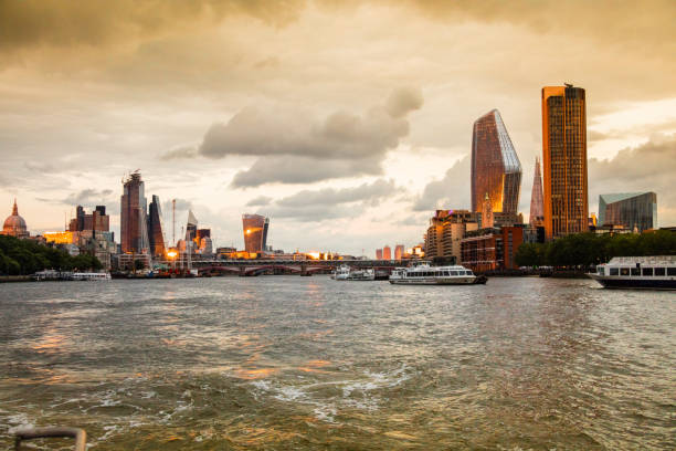 London and thames river at sunset stock photo