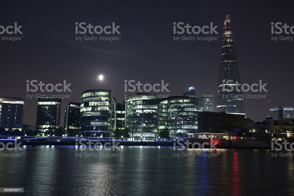 London at night with The Shard peaking above the Thames royalty-free stock photo