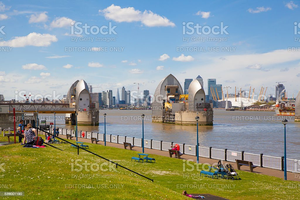 London barrier on the River Thames and playground stock photo