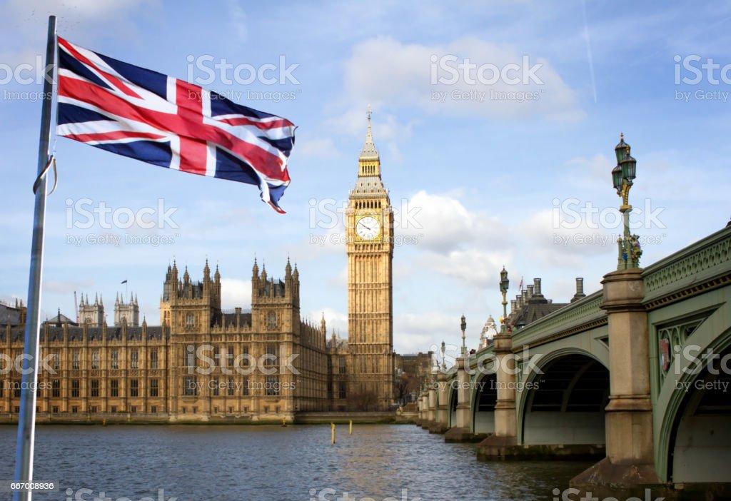 London Big Ben and Westminster bridge and british flag stock photo