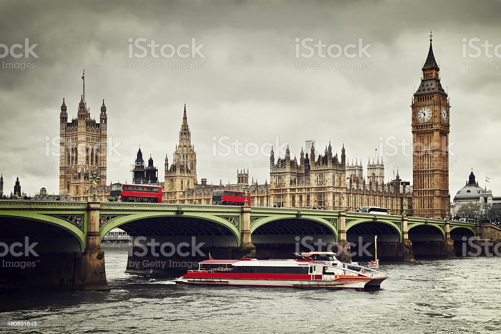 London. Big Ben, River Thames, red buses and boat vintage stock photo