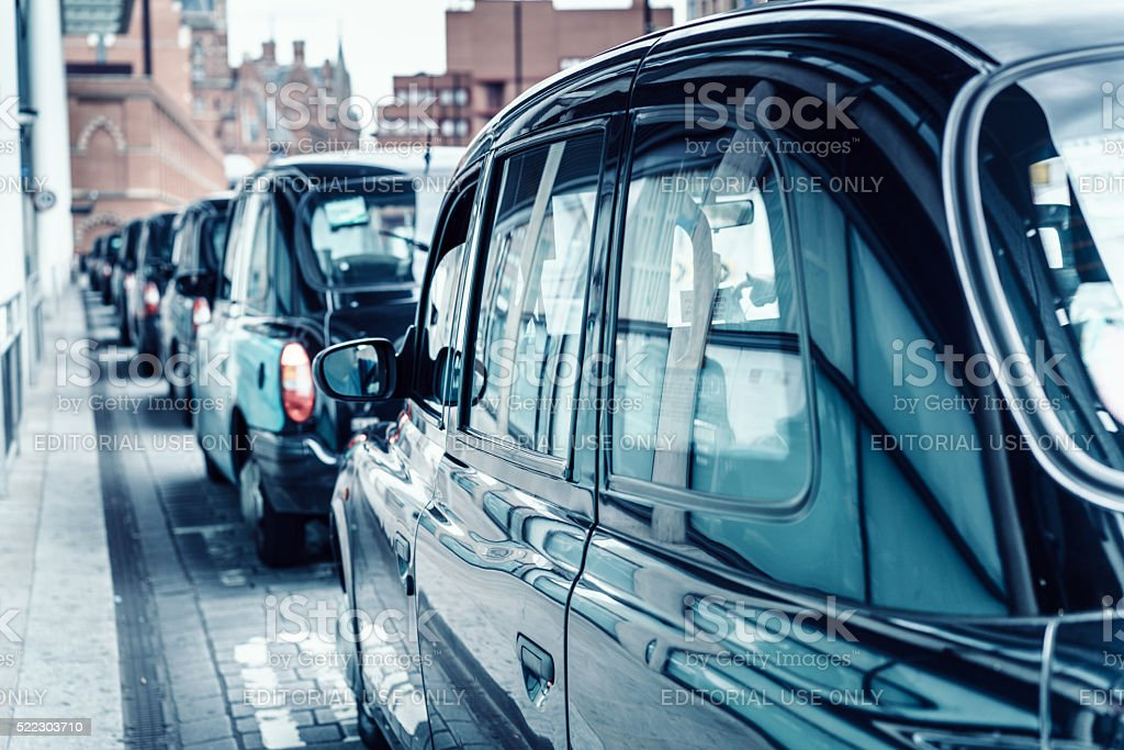 London Black Cab in a line stock photo