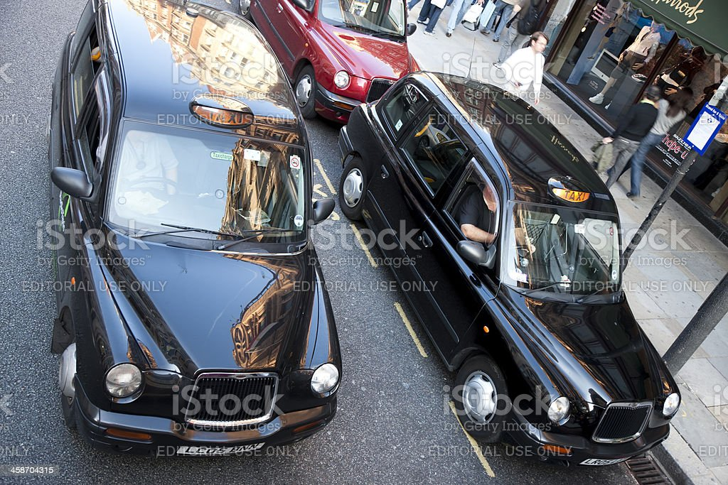 London Black Taxi Cabs Outside Harrods Department Store, Elevated View stock photo