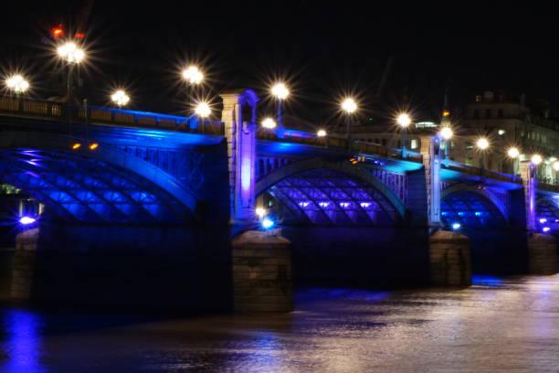 London bridge on the river Thames at night stock photo