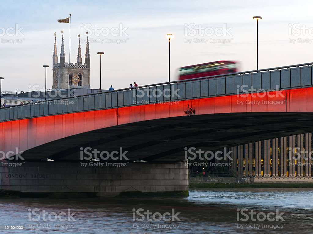 London Bridge over River Thames with bus stock photo