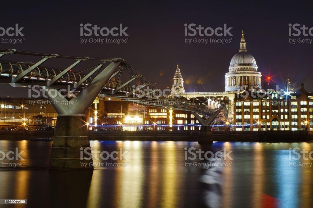 London bridges on the river Thames at night stock photo