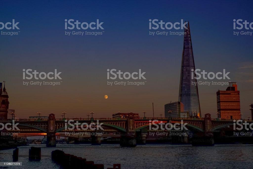 London bridges on the river Thames at sunset stock photo