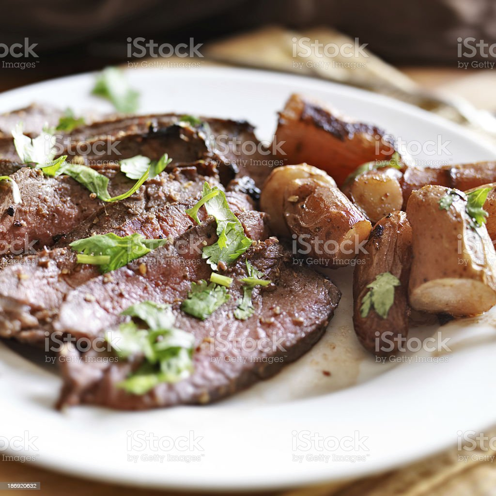 London broil beef roast with french fingerling potatoes stock photo