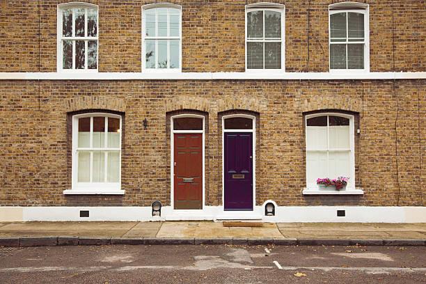 London brownstone facade with sidewalk stock photo