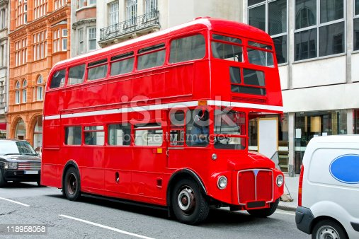 Red double deck bus at heritage route in London.