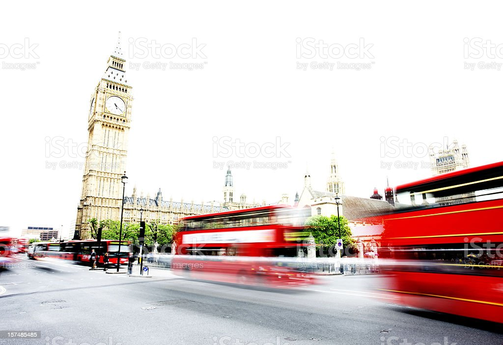 London buses at Westminster Motion blurs of London buses passing Big Ben during the day Big Ben Stock Photo