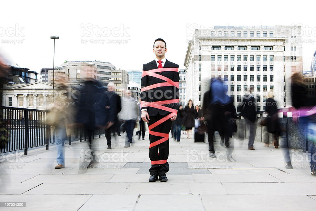 London business man tied up in bureaucracy and red tape stock photo