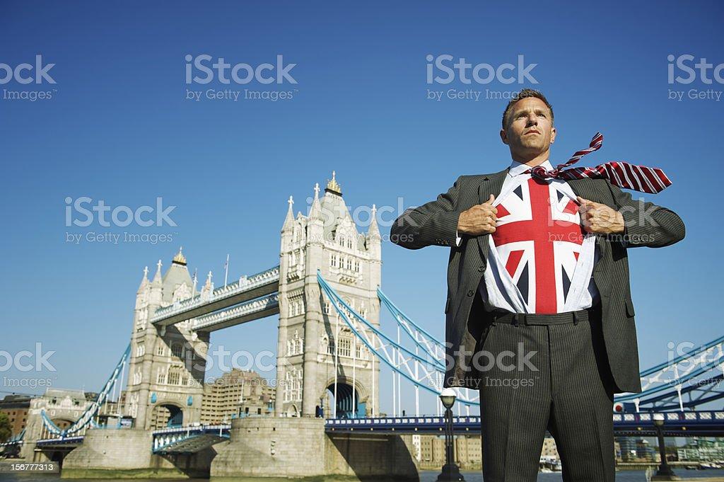 London Businessman Turns Superhero at Tower Bridge royalty-free stock photo