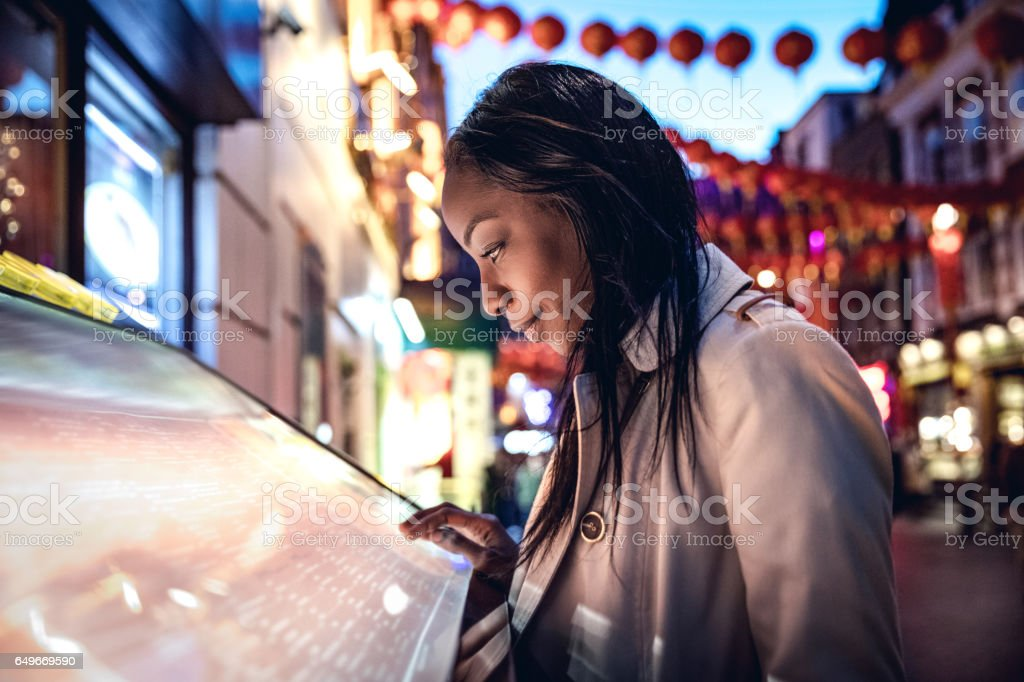 London Chinatown, woman walking in the night and meet friends stock photo