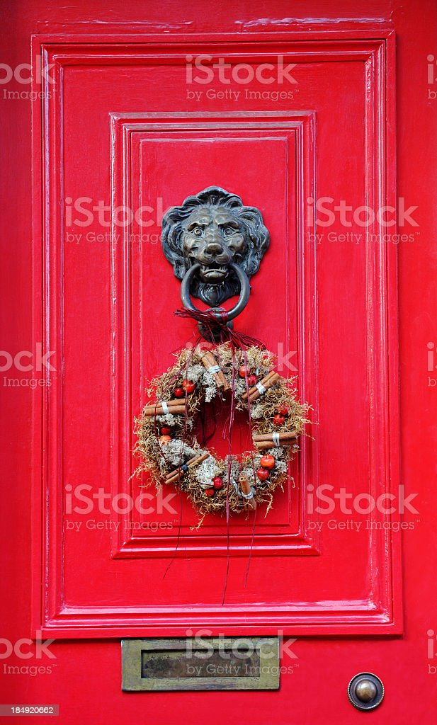\'A period Victorian door with a Lion knocker and Christmas yule...