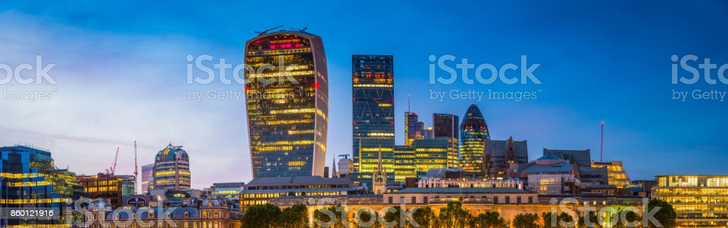 London City Financial District skyscrapers panorama illuminated at sunset UK stock photo