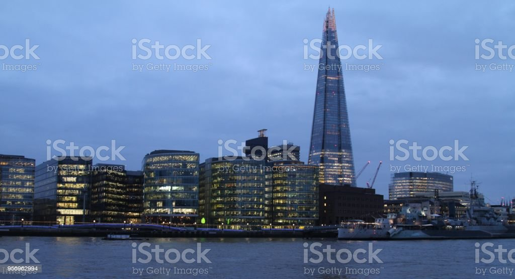 London city skyline on River Thames at night, Southwark area including The Shard stock photo