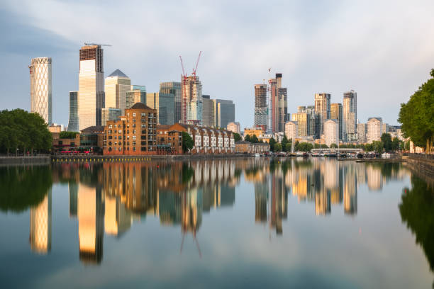 London cityscape Canary Wharf with reflection from Greenland Dock at sunset stock photo