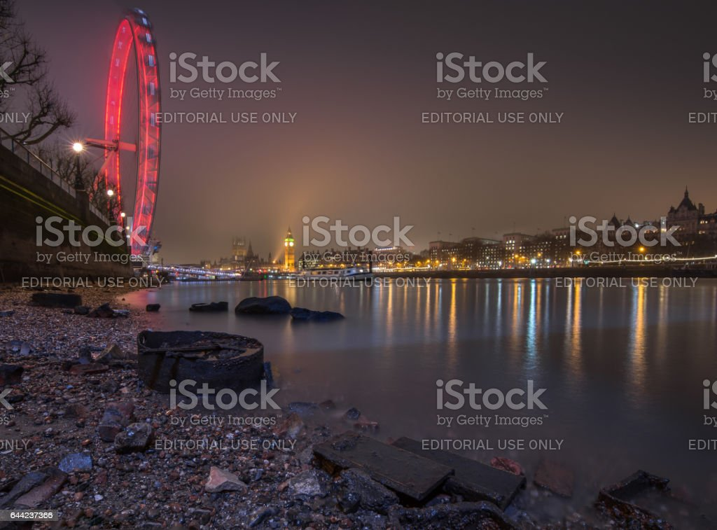 London cityscape from river Thames beach stock photo