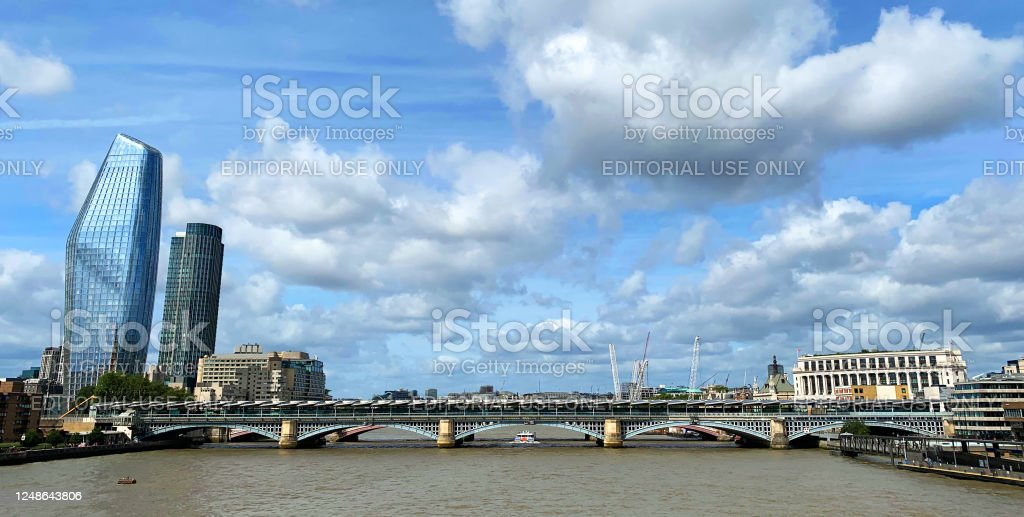 London cityscape London cityscape with futuristic buildings as seen from Thames river, United Kingdom. Architecture Stock Photo