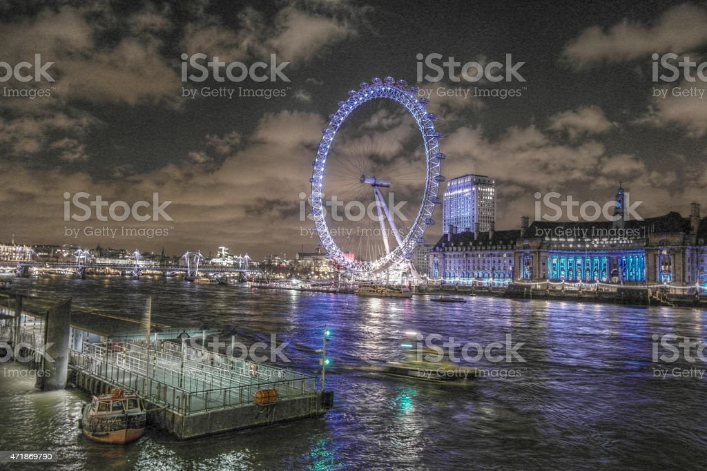 London Cityscape with Millennium Wheel at Night stock photo