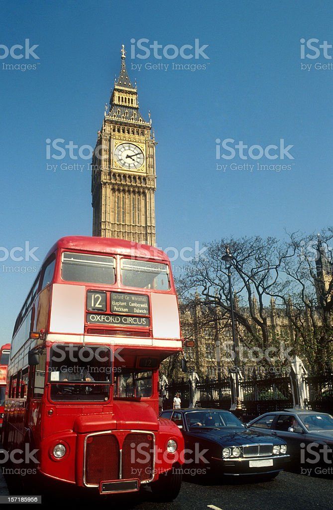 London double decker us and Big Ben houses of parliament royalty-free stock photo