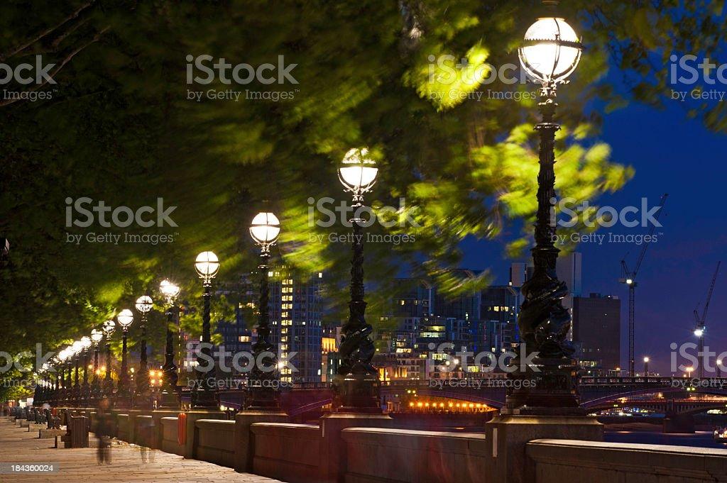 London Embankment lights illuminated night River Thames UK royalty-free stock photo