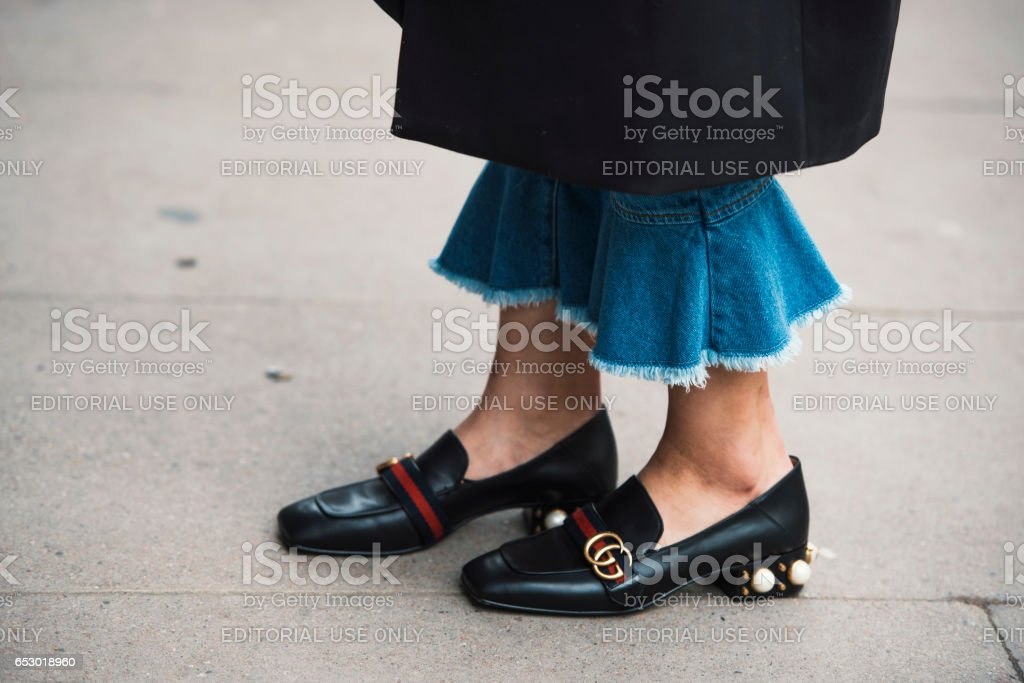 London, England – February 18, 2017: Girl wearing Gucci shoes during London Fashion Week. stock photo