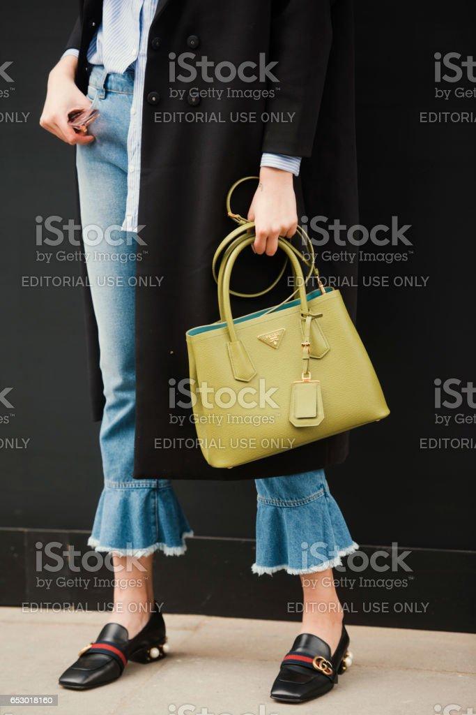 London, England – February 18, 2017: Stylish girl wearing Prada handbag and Gucci shoes, outside the London Fashion Week show. stock photo