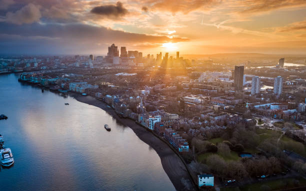London, England - Panoramic aerial skyline view of east London at sunrise with skycrapers of Canary Wharf stock photo