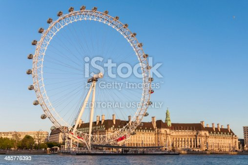 London, United Kingdom - May 10, 2011: London Eye in afternoon sun. The giant Ferris wheel is 135 meters tall and the wheel has a diameter of 120 meters.