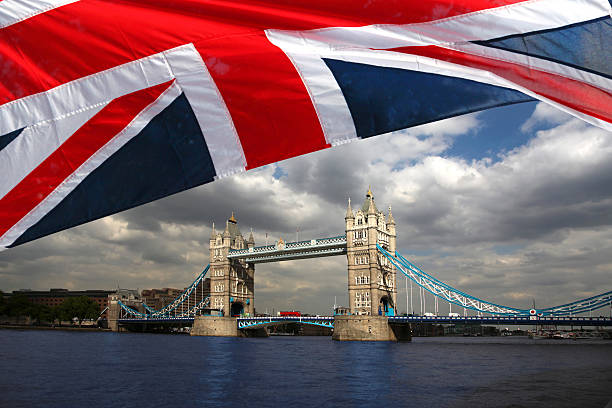 London Famous Tower Bridge With Flag Of England Stock Photo